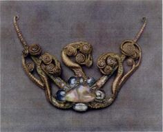 """Medusa"" pendant designed by L.C. Tiffany, 1904. Descirbed in ""The Art-Work of Louis C. Tiffany"" (1914) as ""a marine motif, half crab, half octopus, with the writhing feet split into two or more special ends, [and] arranged for a brooch and set with opals, sapphires, and rubies."" Inspired by Euro avant-garde and art nouveau. Only piece of early LCT jewelry to bear his signature.-Bejeweled by Tiffany"