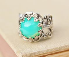 Vintage Green Opal Ring,Minty Green Glass Opal,Silver Filigree Adjustable Ring,Crown Setting,Boho,Everyday,Opal Jewelry,Birthstone,One size by hangingbyathread1 on Etsy https://www.etsy.com/listing/155325106/vintage-green-opal-ringminty-green-glass