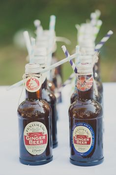Bottled soft drinks with striped paper straws