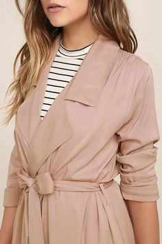 The Easy Breezy Blush Pink Trench Coat has always got your back, no matter the weather! Lightweight woven fabric shapes this versatile trench coat with long sleeves, notched collar, open front, and hidden side-seam pockets. Classic trench details like a storm flap at back, and attached sash belt complete this fashionable staple! Back kick pleat.