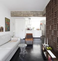 Living Room and Kitchen by Filipe Ramos Design  Apartment situated at Itaim Bibi neighbourhood in São Paulo, Brazil.