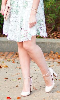 The white lace dress that you need this season - love the floral details and cute nude heels! | Orlando, Florida fashion blogger Ashley Brooke Nicholas