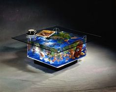 Un acuario en forma de mesa, ideal para el salón de una casa. Table aquarium