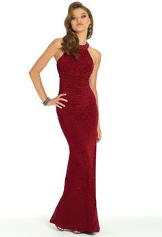 Accentuate your curves in a long sheath dress that will highlight every lovely feature that your body has to offer! This gorgeous evening dress is a knit fabric interwoven with glittering threads to give you a stunning metallic glow throughout the night. The bodice of this dress is shirred to ensure you look and feel you absolute most beautiful! Wear this pretty halter style to a wedding, as a homecoming dress or holiday dress to make the most fabulous fashion statement! Accessorize with…
