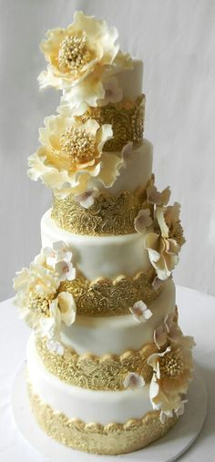 Gold and ivory with sugar flowers.