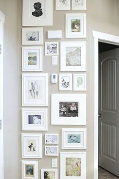 I love the way that Jennifer Johner did this charming art wall of photos and sketches with white matts and frames. One hardly notices the light switch and thermostat. :]