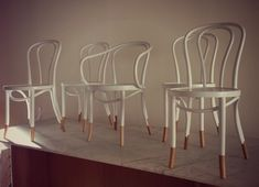 White bentwood chairs with natural sock