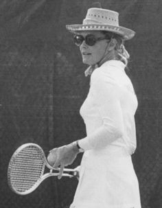Grace playing tennis.