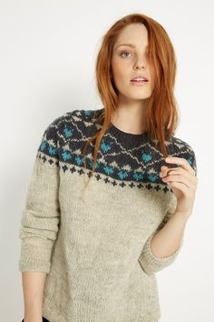 Round-neck jumper with fairlisle yoke. This cosy hand knitted jumper is crafted from soft, springy wool. Elle is 5'7 and is wearing a size M.