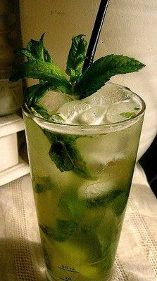 COCONUT WATER MOJITO  2 oz Havana Club 3 year  6-7 mint leaves and more mint to garnish  1 oz fresh coconut water  1 lime  Top with Soda  Simply fill the ice tray with pure coconut water and freeze.  Pound the mint leaves carefully to release the oil but not break the leaves together with the juice of i lime. Fill the glass to the top with ice and add the rum, then the coconut water and a splash of soda. Garnish with mint.