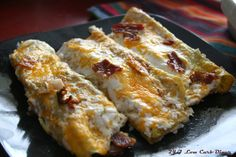 Bacon Breakfast Enchiladas-- Egg wraps filled with bacon, onion, peppers and cheese. Topped off with a cream cheese sauce and a little more bacon. Delish! #lowcarb
