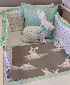 Spoil your darling angel with a Bashful Bunny themed, mint green nursery. The cot bumper is both padded and reversible, making it a necessity in your baby's nursery. This range of baby linen is matched with a soft, bunny plushie, and mint green, polka dotted scatter cushions. This collection is apart of our Bashful Bunnies range, and can bring smiles to anyone who enters your baby's nursery.   Check out our other ranges at: www.studiocollection.co.za