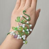 How to Make a Wire Wrap Pearl Bracelet with Ring Attached