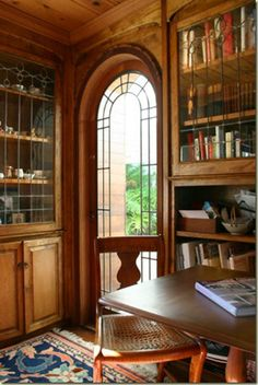 Wood paneled library with leaded glass