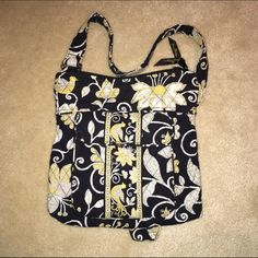 Host Pick 4/6/16 VB black floral pattern bag Host Pick Sale 4/6/16 only!!NWOT RETIRED Vera Bradley shoulder bag in black, yellow, & white pattern. Pics show outside & bag turned inside out so that you can see how clean the inside is. No stains, holes, rips, or pulled threads. No odors. Handles are in excellent, like new shape. Matching wallet available in separate listing! Can be purchased together at 20% discount! I'm open to offers & give other bundle discounts, too!! ☮❤️✌️ Vera Bradley…