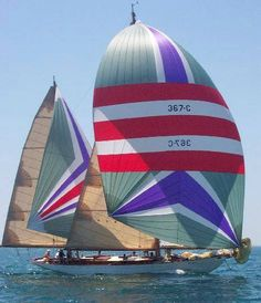 Erie, PA - Dreamer, a 55 foot 1929 Alden Ketch sailboat with it's spinnaker flying.