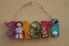 Wood sign with polymer clay embellishments