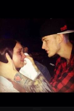 Machine Gun Kelly wiping away tears, this is why his fans love him.