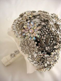"""Brooch this is the most beautiful brooch bouquet I've seen. Also love the """"i do"""" on the handle. - how to create the perfect brooch bouquet, you may be wondering just what we mean. While many brooch bouquets are downright gorgeous, there is one way to . Broach Bouquet, Wedding Brooch Bouquets, Button Bouquet, Brooch Bouquet Tutorial, Broschen Bouquets, Wedding Crashers, Wedding Trends, Wedding Ideas, Wedding Planning"""
