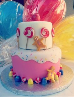 Candyland cake i love the bottom tier with sprinkles!!!