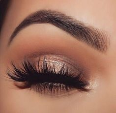 Shimmer and tan eyeshadow for a natural look. Perfect eye brows!