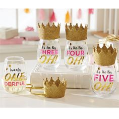 """21 Stemless Wine Glass - This 2-piece set includes a stemless wine glass with a festive wearable birthday hat. The glass features gold foil embellished """"Twenty ONE DERFUL"""" message. Celebrate turning 21 in style. From Mud Pie.  Size: glass 16 oz 