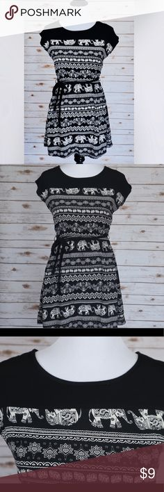 🐘 Black & White Elephant Printed Dress 🌱Black and white tunic top  🌱Elephant printed design  🌱With black waist tie strap  🌱Cotton breathable material  🌱Casual summer/spring/beach dress  🌱Good for casual wear  🌱Great for wearing on vacation  ✔️No rips or cuts  ✔️No signs of wear  ✔️Excellent condition    I am willing to ⬇️  the price, just like ❤️ the product and or leave me a comment! Dresses Mini