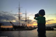 Sea legs: Mr Whyte caputes an image of HMS Warrior in Portsmouth harbor, while his trusty ...