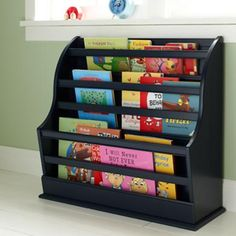 Painted book storage - display style shelving for little hands' easy access.