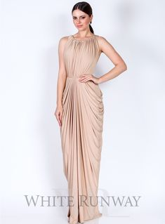 Exclusive Kienna Dress. A full length dress by Pia Gladys Perey. Features a high neckline on the front and back, and draped skirt detailing.