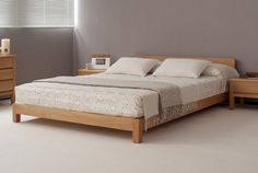 Hand-built, the Nevada is a quality, contemporary, low wooden bed. Perfect for stylish lofts and small spaces. UK Made. Buy Online. Free UK Delivery.