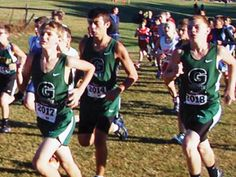 Submitted i360photo Greenville's Jacob Subler, Pryce Durnye and Ryan Trick run at Saturday's junior high cross country meet.