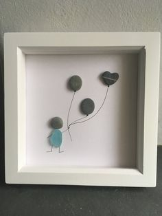 An original and handmade sea glass and pebble artwork. Framed picture. Person with pebble balloons and heart. Engagement gift. Birthday gift. Anniversary gift. All pebbles and sea glass were found by me, washed up on beaches across Cornwall, on long walks in all weathers. White