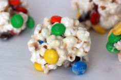 Easy Popcorn balls. Easy treat for a class party could use candy corn or halloween mm