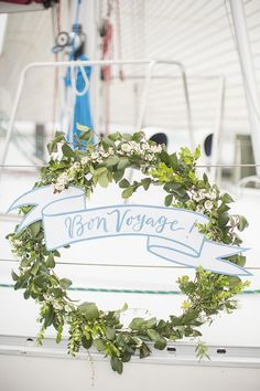 Bon voyage wreath | Read More: http://www.stylemepretty.com/little-black-book-blog/2014/07/08/seaside-garden-wedding-inspiration/ | Photography: Alicia Pyne Photography - www.aliciapyne.com