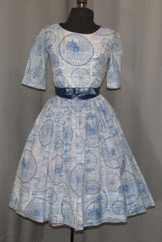 This vintage 1950s dress , made by Jonathan Logan, is the most unique and unusual print in, I believe, a silk blend fabric . The fabric is very light and sheer in a dark blue…