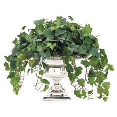 This is faux, but ivy planted in silver urns would be pretty.