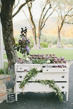favor table or any kind of table with this type of greenery