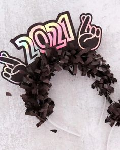 Make your own cautiously optimistic 2021 headband for New Year's Eve! Get the free cut file and full instructions at persialou.com