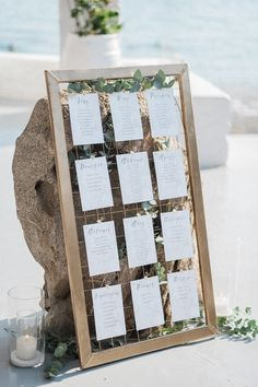 View seaside wedding decorations, table decoration, bride & groom and more. MA Mykonos weddings planner offers VIP and tailor made wedding services Mykonos Island, Wedding Decorations, Table Decorations, Seaside Wedding, Seating Charts, Plan Your Wedding, Bride Groom, Wedding Planner, Frame