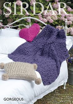Love this heart and pom pom pillow