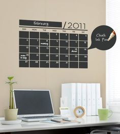 """This chalkboard wall calendar is a vinyl wall decal including replaceable digits for the year. Measuring 15x22"""" with large 3x2"""" squares for each day. Combine this set with the Chalk Ink Pens for a great addition to your office space. $35 for vinyl chalkboard calendar, $5 for chalk pen.  (via SimpleShapes)"""