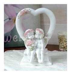 http://www.lespritdesanges.com/anges-pour-mariage/251-figurine-anges-assis-dans-un-coeur.html Les petits bisous des anges ça fait du bien .