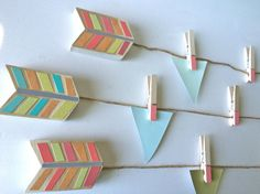Let your child proudly display their work of art with these handcrafted, eco-friendly arrows and clips.. Or maybe display printed art or family