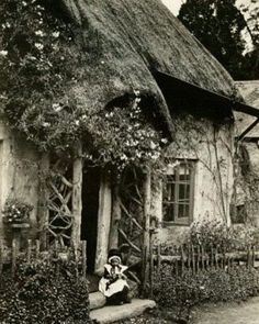 """Someone labeled this """"In rural England, a child sits outside an old English cottage."""" I think the child has on a Welsh costume so it wouldn't be England - it is the beautiful country of Wales! Witch Cottage, Storybook Cottage, Old Pictures, Old Photos, Vintage Photographs, Vintage Photos, England, English Countryside, Old English"""