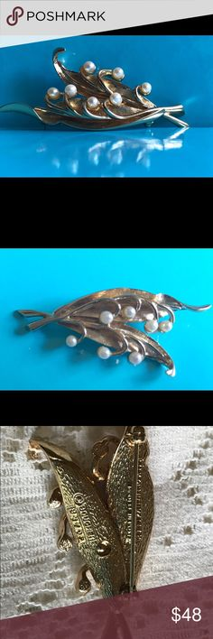 "Vintage Marcel Boucher Lily of the Valley Brooch This stunning 1960's brooch signed Boucher Lily of the Valley #8370P. The metal is gold tone with pearls ( Not sure if they are cultured or faux.)  Lily of the Valley was for May. The pearls are tight and the clasp works well.  Measures 2 1/2"" long and 1 inch wide.  A great piece to add to your jewelry collection! Marcel Boucher Jewelry Brooches"