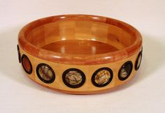 Segmented wooden bowl with stone inlay (Red Creek Jasper).by HWRWood, etsy [I could go crazy filling these indents with coins, cabazons, family pictures, etc.]