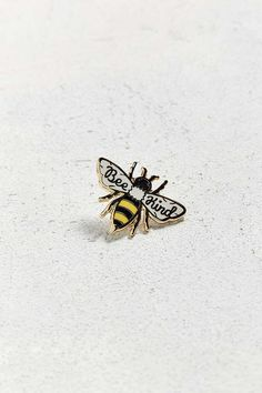 Remember to stay sweet with this buzzworthy pin from Beholder. Bumblebee-shaped pin in glossy enamel and gold-tone metal edging + linework. Complete with a rub…