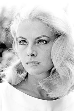 Virna Lisi's classic style. Note the softly curled/wavy hair, muted lip, bold lined eyes, and beauty mark.