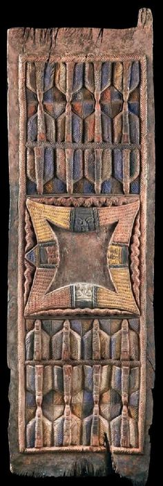 Africa | Old Palace door from the Yoruba people of Nigeria | Wood, paint/pigment | In the style of Olówè von Isè (1875 - 1938) has most probably been carved by one of his students.